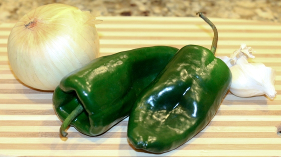 Look for poblano peppers that are dark green and firm.